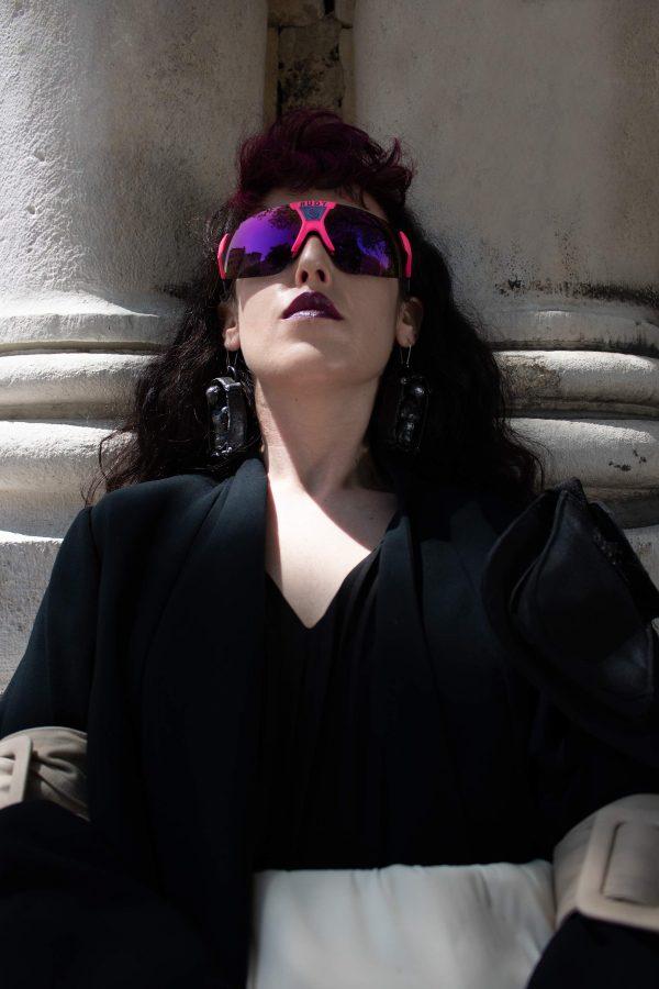 woman with handmade sculpture earrings black venus forms