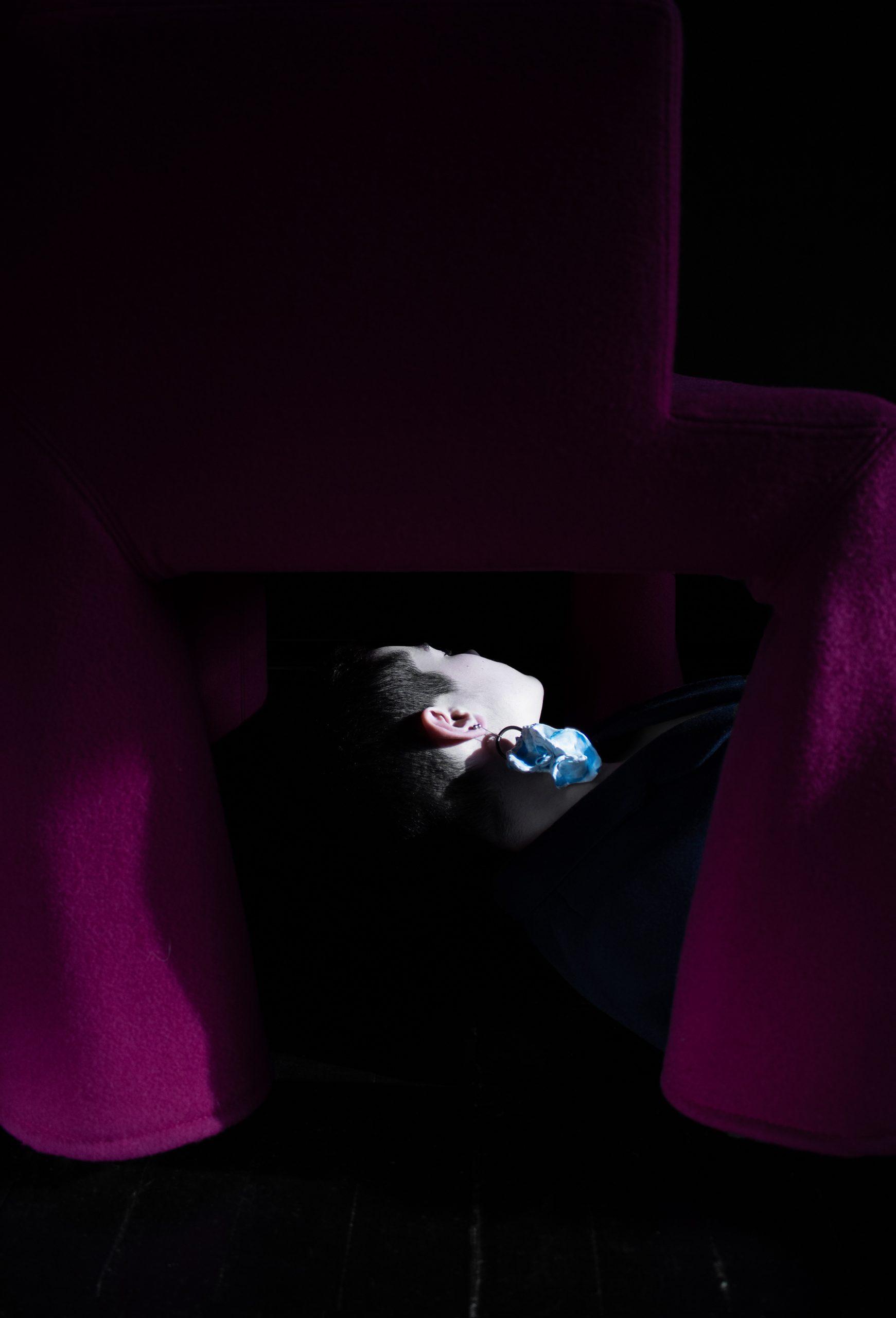 flexible tongue beautiful woman blue sculpture earrings portrait photography